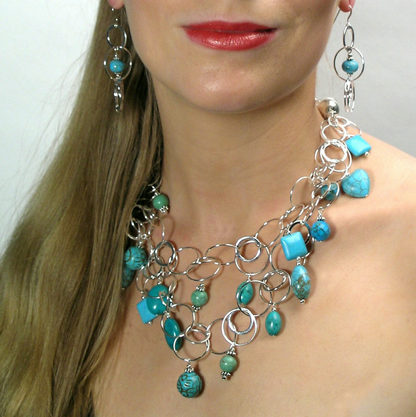 "#16014 <br>Magnesite turquoise and pewter drops<br>On silver plated multi-loop chain. <br>Magnetic clasp. <br> Wear long at 37"" or doubled at 18.5"" (as shown)Limited Edition $195.00<br>Earrings with  sterling silver ear wires $35.00"