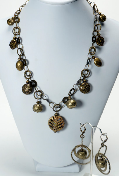 "#13620<br>Bronze chain <br>With assorted bronze beads.<br>Antiqued bronze clasp<br>And 4"" extender chain.<br>17"" to 21"" Limited Edition.<br>Necklace $75.00<br>Earrings $30.00"