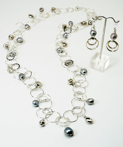 "#13117 <br>Silver pearls and pewter drops <br>on multi-loop silver plated chain. <br>Magnetic clasp. <br>Wear long at 36"" (as shown)or doubled at 18"" <br>Necklace Limited Edition $37.00<br>Earrings with silver plated French clips $37.00"