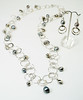 """#13117 <br>Silver pearls and pewter drops <br>on multi-loop silver plated chain. <br>Magnetic clasp. <br>Wear long at 36"""" (as shown)or doubled at 18"""" <br>Necklace Limited Edition $37.00<br>Earrings with silver plated French clips $45.00"""
