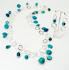 """#14917 <br>Turquoise, magnesite turquoise and pewter drops<br>On silver plated multi-loop chain. <br>Magnetic clasp. <br> Wear long at 37"""" (as shown)or doubled at 18.5"""" Limited Edition $195.00<br>Earrings with  sterling silver ear wires $45.00"""
