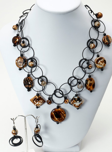 "#15917<br> Leopard agate and black onyx on matte Nite black chain. <br>Nite black clasp and 4"" extender chain.<br>Necklace 16.5"" to 20.5"" Limited Edition  $150.00<br>Earrings with gunmetal French clips $36.00"