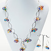 "#24318<br>Millefiori glass and multi-corled crystal<br>On silver plated chain.<br>Silver plated clasp<br>And 4"" extender chain.<br>19"" to 23"" Limited Edition.<br>Necklace $150.00<br>Earrings$35.00"