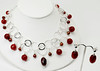 """#28716<br> Ruby jade and cranberry pearls <br>on multi-loop silver plated chain.<br>Silver plated clasp and 4"""" extender chain. <br>Necklace 17"""" to 21"""" Limited Edition $150.00<br>Earrings with silver plated posts $26.00"""