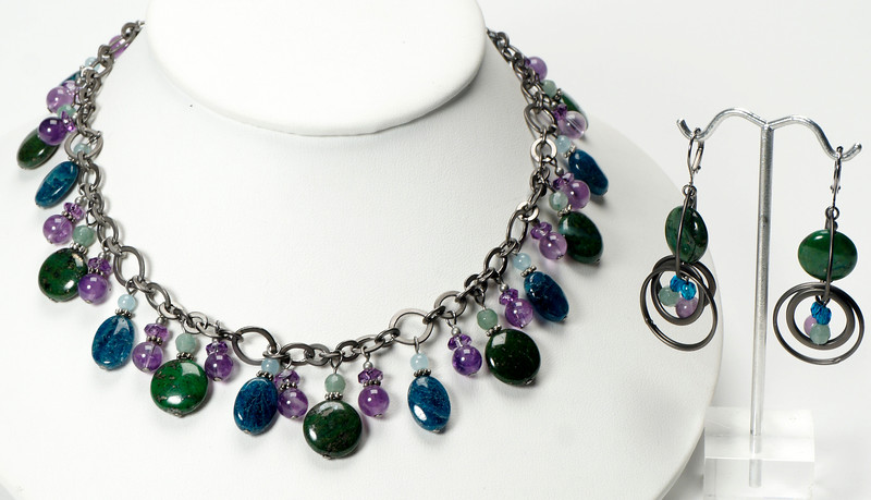 """#14220<br>Amethyst, green pyrite<br>Apatite and green aventurine.<br>Gunmetal chain, clasp and 4"""" extender chain.<br>&lt;16"""" to 19"""" Limited Edition.<br>necklace $175.00<br>Earrings $38.00"""