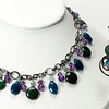 "#14220<br>Amethyst, green pyrite<br>Apatite and green aventurine.<br>Gunmetal chain, clasp and 4"" extender chain.<br>&lt;16"" to 19"" Limited Edition.<br>necklace $175.00<br>Earrings $38.00"