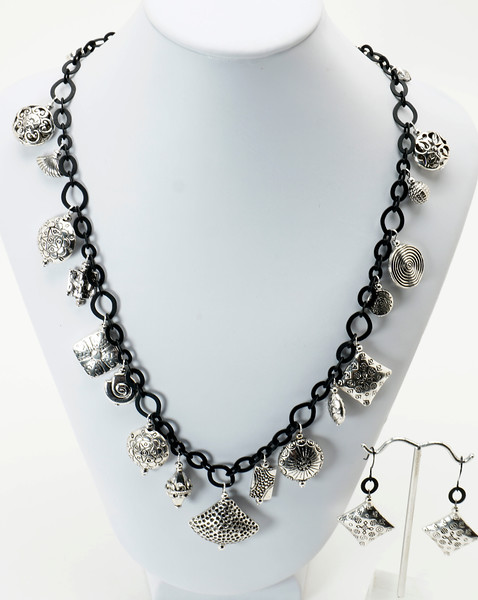 """#19219<br>Pewter charms on<br>Nite black chain, clasp and 4"""" extender chain.<br>18"""" to 22"""" Limited Edition.<br>Necklace $99.00 Earrings $25.00"""