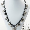 "#19219<br>Pewter charms on<br>Nite black chain, clasp and 4"" extender chain.<br>18"" to 22"" Limited Edition.<br>Necklace $99.00 Earrings $25.00"