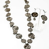 """#22219<br>Stamped gunmetal chain<br>And gunmetal coild beads.<br>With antiqued silver filigree drop.<br>32"""" Limited Edition.<br>Necklace $99.00<br>Earrings $29.00"""
