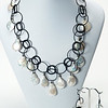 "#12520<br>Natural teardrop pearls<br>On multi-loop nite black chain,<br>Clasp and 4"" extender chain.<br>17"" to 21"" Limited Edition. <br>Necklace $175.00<br>Earrings $36.00"