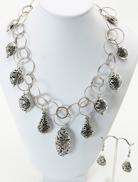 "#12819<br>Pewter scroll drops <br>On antiqued silver chain, clasp <br>And 4"" extender chain.<br>17"" to 21"" Limited Edition.<br>Necklace $125.00 Earrings $24.00"