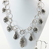"""#12819<br>Pewter scroll drops <br>On antiqued silver chain, clasp <br>And 4"""" extender chain.<br>17"""" to 21"""" Limited Edition.<br>Necklace $125.00 Earrings $24.00"""