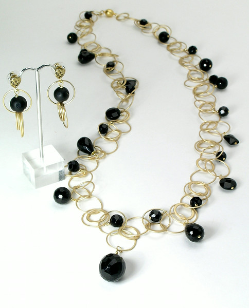 "#16614 <br>Black onyx on multi-loop matte gold chain<br> with magnetic clasp. <br>Wear long at 36""(as shown) or doubled at 18"" <br>Limited Edition $195.00<br>Earrings with matte gold chain and ABD bronze posts $44.00"