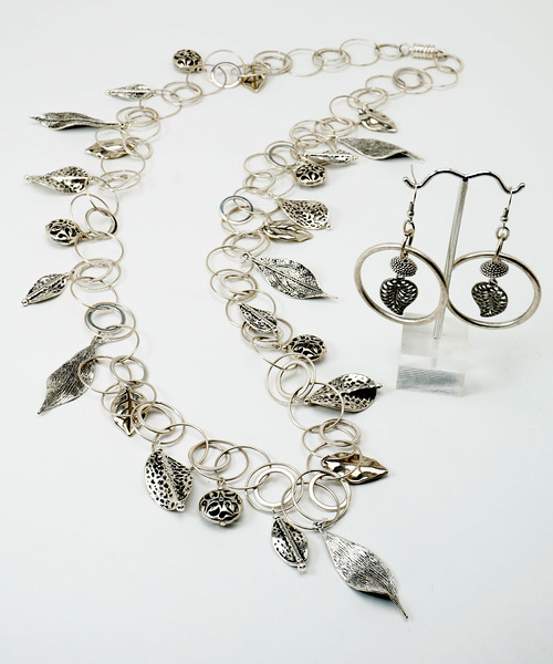"#10717 <br>Pewter leaves on silver plated multi-loop chain. <br>Magnetic clasp. <br>Wear necklace at 36"" (as shown) or doubled at 18"" Limited Edition $150.00<br>Earrings not available."