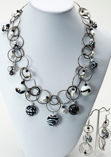 "#18917<br>Lamp glass and glass pearls on antiqued silver multi-loop chain. <br>Antiqued silver clasp and 4"" built-in extender chain.<br>Necklace 16"" to 20"" Limited Edition. $150.00<br>Earrings with surgical steel ear wires $38.00"