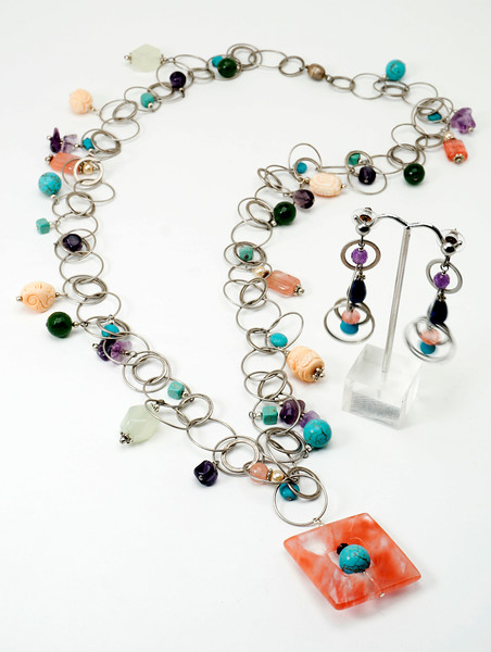 "#10617 <br>Strawberry quartz and turquoise drop<br> on multi-loop antiqued silver plated chain <br>with pink coral, serpentine jade, amethyst, strawberry<br> quartz and magnesite turquoise. <br>Magnetic clasp. <br>Wear at 36"" (as shown)or doubled at 18"" <br>Limited Edition $199.00<br>Earrings with silver plated posts $39.00"