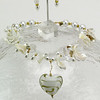 "#16512 <br>White and gold lamp glass heart on<br> quartz, shell, crystal, tourmaline quartz and glass pearls. <br> Gold plated clasp and 4"" extender chain.<br> Alice Bailey Designs signature tag. <br> Necklace 18""  to 22""  $175.00<br>  Earrings with gold plated French clips $25.00"