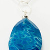 "#15819<br>Color-treated Petoskey stone drop<br>On 36"" silver plated chain.<br> Limited Edition. $85.00"