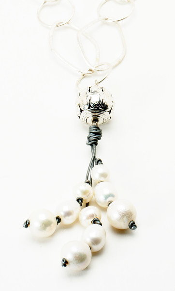 "#16719<br>Pewter ball with white pearls,<br>silver leather and silver plated chain.<br>36"" Limited Edition.<br>$135.00"