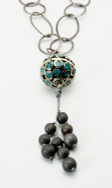 """#16619<br>Turquoise and gunmetal/bronze ball<br>With gunmetal stardust beads, leather and silver plated chain.<br>36"""" Limited Edition.<br>$150.00"""