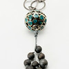 "#16619<br>Turquoise and gunmetal/bronze ball<br>With gunmetal stardust beads, leather and silver plated chain.<br>36"" Limited Edition.<br>$150.00"