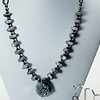 "#13020<br>Silver quartz druzy pendant<br>On hematite.<br>Gunmetal chain, clasp<br>And 4"" extender chain.<br>17.5"" to 21.5"" Limited Edition.<br>Necklace $99.00<br>Earrings $27.00"