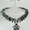 """#10014 <br>Snowflake obsidian, smokey quartz and<br>sterling silver pendant on snowflake obsidian. <br>Sterling hook clasp and 4"""" extender chain. <br>Alice Bailey Designs Signature Tag.<br> Necklace 17.5"""" to 20"""" One-of-a-kind $350.00<br>Earrings with sterling silver French clips $48.00"""