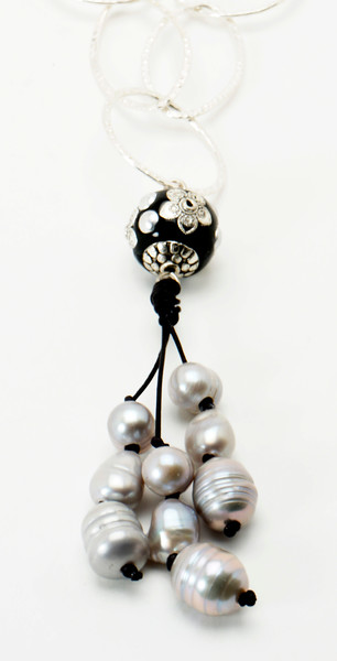 "#16819<br>Glass and pewter ball <br>With silver pearls and black leather.<br>Silver plated chain.<br>36"" Limited Edition.<br>$150.00"