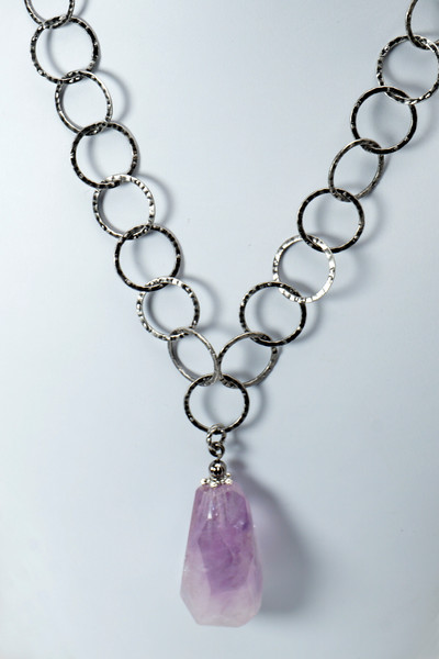 "#25916<br> Amethyst drop on gunmetal chain and clasp. <br> 20"" or less. Limited Edition $95.00<br> Note: natural stones will vary."