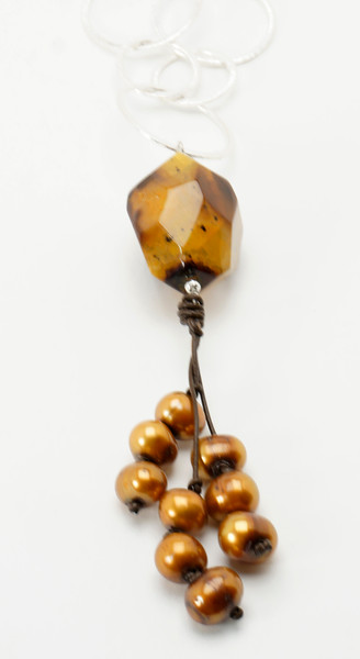 "#16419<br>Topaz fire agate,bronze pearls,<br> And brown leather On silver plated chain.<br>36"" One-of-a-kind. <br>$150.00"
