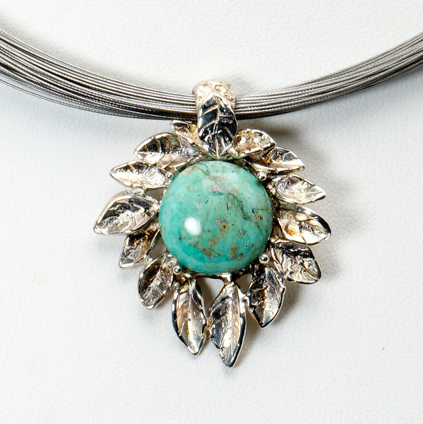 "#12917<br>ABD silver leaf and turquoise pendant<br>On multi-strand steel neck wire.<br>Silver plated clasp and 4"" extender chain. <br>16"" to 20"" Limited Edition."