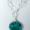 """#26416 Turquoise and pewter drop on silver plated chain and clasp. <br> 20"""" or less. Limited Edition.  <br><br><a href=""""https://www.paypal.com/cgi-bin/webscr?cmd=_cart&add=1&business=alice@AliceBaileyDesigns.com&item_name=Alice%20Bailey%20Designs%20Item%20Number%2026416%20Necklace&item_number=26416&amount=%2495.00&return=http://www.paypal.com&cancel_return=http://www.paypal.com"""" target=""""_click"""" class=""""paypalbutton"""">Purchase Necklace $95.00</a><br><br>"""