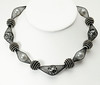 """#15517 <br>Glass pearls caged in black nylon with """"beaded beads"""". <br>Nite black clasp and 4"""" extender chain. <br> 16"""" to 20"""" Limited Edition $95.00"""