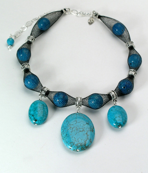 "#12114 <br>Three magnesite turquoise and pewter drops <br>on magnestie turquoise stuffed nylon. <br>Silver plated clasp and 4"" extender chain. <br> Alice Bailey Designs signature tag. 16"" to 20"" Limited Edition $95.00"