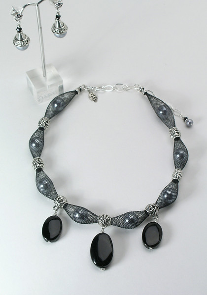 "#15014 <br>Black onyx drops on pewter, glass pearls and nylon. <br>Silver plated clasp and 4"" extender chain. <br> Alice Bailey Designs signature tag. <br>Necklace 16"" to 20"" Limited Edition $95.00<br>Earrings with pewter and surgical steel posts $25.00"