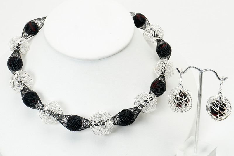 """#21717<br> Silver wire wraps and  rubber on nylon tubing. <br> Silver plated clap and 4"""" extender chain.<br>16"""" to 20"""" Limited Edition.<br> Necklace $95.00<br> Earrings with silver plated French clips $31.00. <br>Extremely lightweight!"""