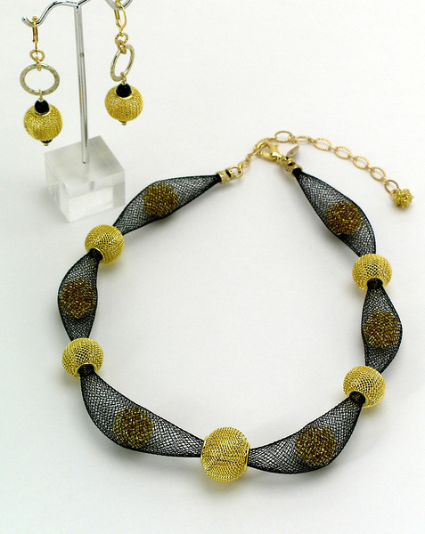 """<font   color=""""000080""""> #20312 Black nylon mesh with gold plated wire wrapped beads. Gold plated clasp and 4"""" extender chain. <br>Alice Bailey Designs signature tag.<br>  17"""" to 21"""" Limited Edition.<br> Necklace $142.50  Earrings $39.00"""