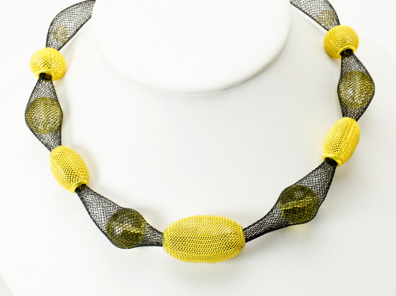 "#17019<br>Yellow mesh and crystal<br>On nylon.<br>Silver plated clasp and 4"" extender chain. <br>16"" to 20"" Limited Edition.<br>$95.00"