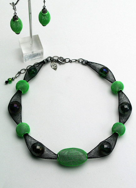 "#16413 <br>Lime mesh and glass on black nylon tubing. <br>Gunmetal clasp and 4"" extender chain.  <br>Alice Bailey Designs signature tag.<br>Necklace 16"" to 20"" Limited Edition $95.00<br>Earrings with gunmetal French clips $26.00"