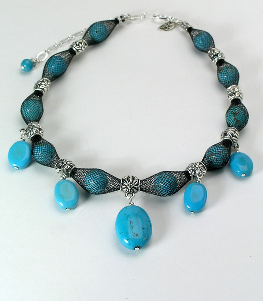 "#12214 <br>Five magnesite turquoise and pewter drops <br>on magnestie turquoise stuffed nylon. <br>Silver plated clasp and 4"" extender chain. <br> Alice Bailey Designs signature tag. <br>16"" to 20"" Limited Edition $95.00"