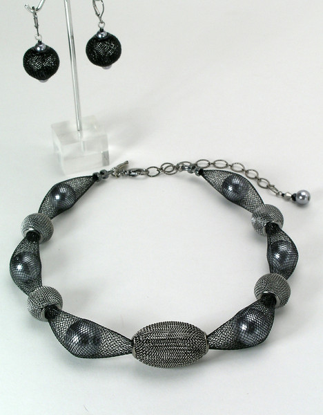 "#25613<br> Dark silver glass pearls, gunmetal mesh and nylon. <br>Gunmetal clasp and 4"" extender chain. <br>Alice Bailey Designs signature tag. <br>Necklace 16"" to 20"" Limited Edition $95.00<br>Earrings with gunmetal French clips $26.00"