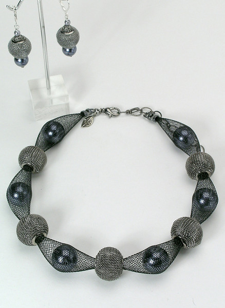 "#23512 <br>Gunmetal mesh, Swarovski crystal pearls and black nylon.<br> Gunmetal Clasp and 4"" extender chain. <br>Necklace 16"" to 20"" Limited Edition $95.00<br>Alice Bailey Designs signature tag.<br>Earrings with gunmetal French clips $26.00"