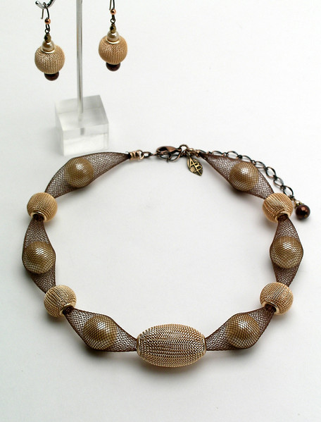 "<font> #14913 <br>Champagne mesh and glass pearls <br>on brown nylon tubing. <br>Antiqued copper clasp and 4"" extender chain.<br>Alice Bailey Designs signature tag.<br>Necklace 16"" to 20"" Limited Edition $95.00<br>Earrings with hypo-allergenic Niobium ear wires $37.00</font>"