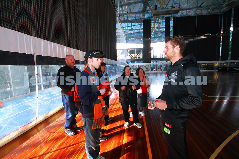 14-6-15. AFL Multicultural Programs Community Ambassadors Joel and Ryan Kuperholz at the Collingwood Football Club's training and membership centre, taking Jewish Care residents to the football. Tim Hunt from Collingwood. Photo: Peter Haskin