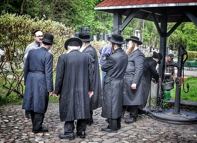 There was an interesting timelessness in these hasidim at the entrance to this age-old cemetery.