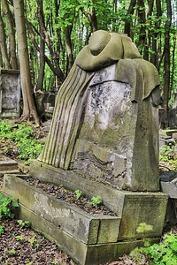 One of the remarkably different and creative tombstones to be found in the cemetery.