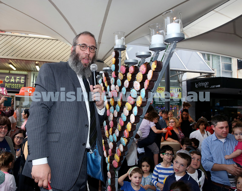 Jewish House Chanukah Party in Bondi Junction Mall. Rabbi Mendel Kastel lights the giant cupcake Menorah. Pic Noel Kessel.
