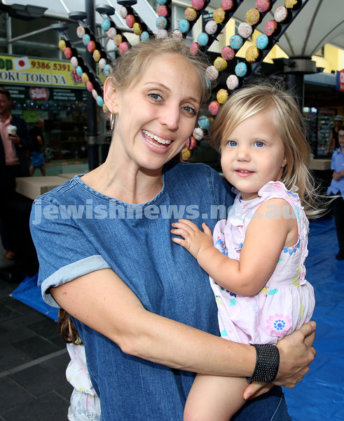 Jewish House Chanukah Party in Bondi Junction Mall. Lorin Muhlmann with her daughter Regina. Pic Noel Kessel.