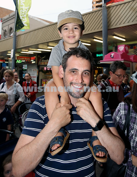 Jewish House Chanukah Party in Bondi Junction Mall. Baruch Kluwgant with his son Daniel. Pic Noel Kessel.