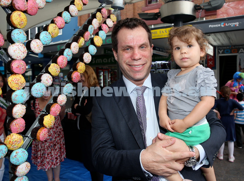 Jewish House Chanukah Party in Bondi Junction Mall. Colin Samuel with his daughter Jessica. Pic Noel Kessel.